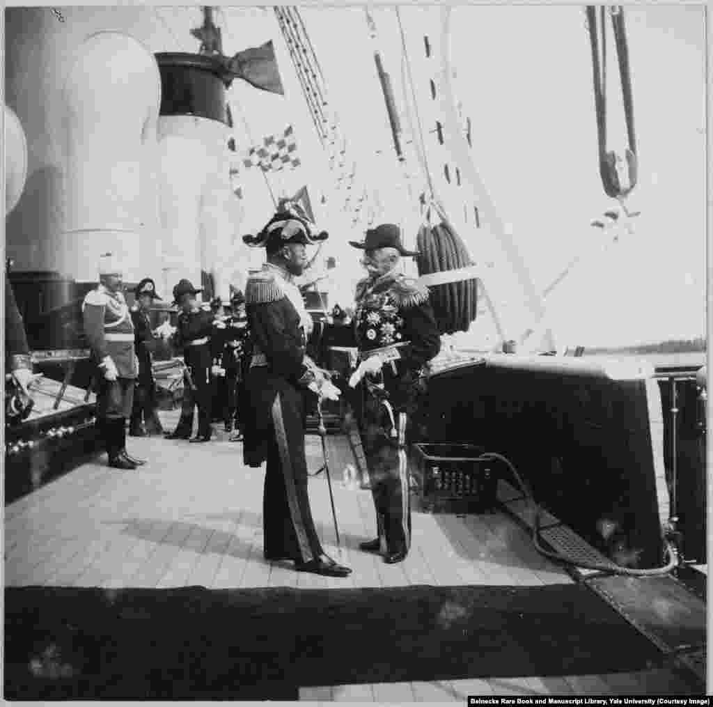 Tsar Nicholas II (left) greeting an unidentified man aboard the Standart. (A previous version of this caption incorrectly identified the man on the right as King Gustav of Sweden.)