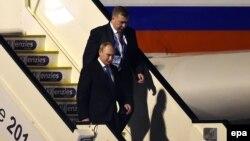 Russian President Vladimir Putin (left) arriving in Brisbane on November 14.