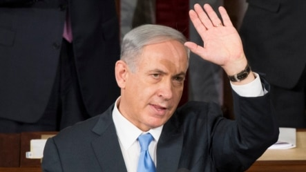 U.S. -- Prime Minister of Israel Benjamin Netanyahu waves after delivering remarks to a joint meeting of Congress on the floor of the US House of Representatives, in the US Capitol in Washington DC, 03 March 2015.