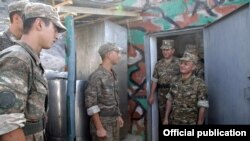 Armenia - Defense Minister Seyran Ohanian (R) talks to soldiers on frontline positions in Tavush region, 8Aug2012.