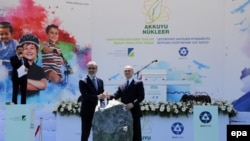 Turkey -- Turkish Energy Minister Taner Yildiz (L) and Rosatom CEO Sergei Kiriyenko attend a ceremony of Akkuyu Nuclear Power Plant in Mersin, April 14, 2015