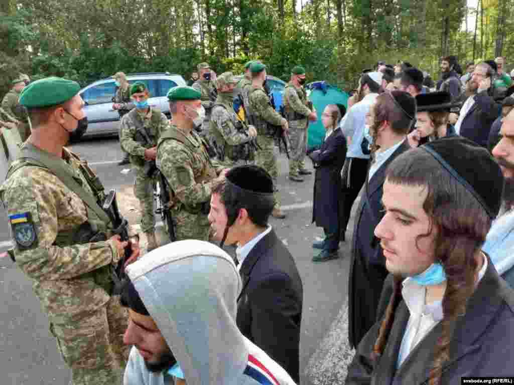 Ukrainian border guards keep an eye on Hasidic pilgrims.