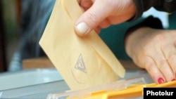 Armenia -- A voter casts a ballot.