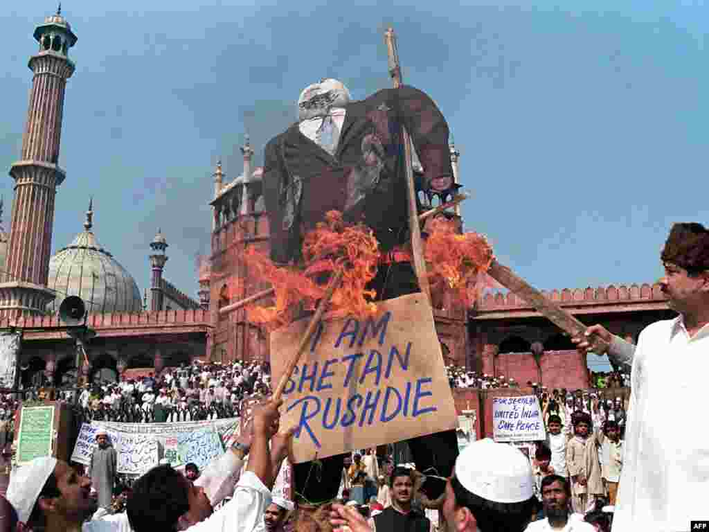 Muslims burn an effigy of Indian-born British author Salman Rushdie as they shout antigovernment slogans during a demonstration near India's largest mosque in New Delhi in February 1999.