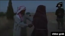 The video, whose authenticity cannot be verified, shows a young woman clad in black, with several IS militants and a man who appears to be her father.