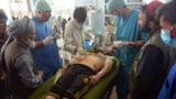 An Injured man receives treatment at a hospital in Ghazni Province on August 12.
