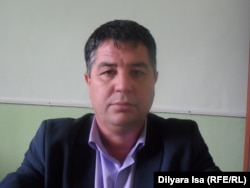 Надырхан Усманов, председатель избирательного участка №587. Шымкент, 24 марта 2016 года.