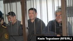 """Трое из 45 подсудимых по """"Хоргосскому делу"""". Алматы, 11 марта 2014 года."""