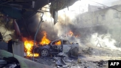 Vehicles burn following an explosion in the town of Darkush, in Syria's Idlib Province, on October 14.