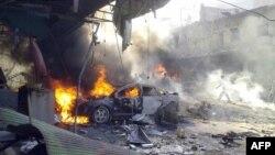 Последствия взрыва в городе Даркуш в провинции Идлиб. Сирия, 14 октября 2013 года. Иллюстративное фото.