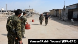 Syrian Democratic Forces patrolling in Raqqa last month