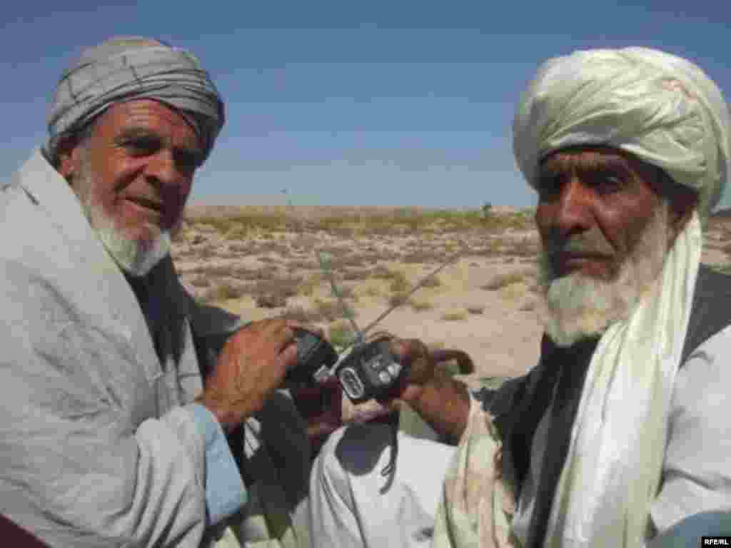 ...2 men in Farah, where 800 radios were handed out...
