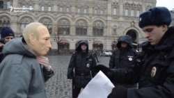 Protester Arrested For Wearing Putin Mask In Red Square
