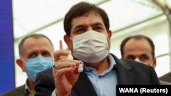 Mohammad Mokhber has been serving as head of a sprawling state conglomerate, whose subsidiary produced Iran's first local COVID-19 vaccine. (file photo)