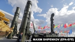 A visitor walks in front of a Russian Antey 4000 antiaircraft missile system at the International Military-Technical Forum Army-2021.