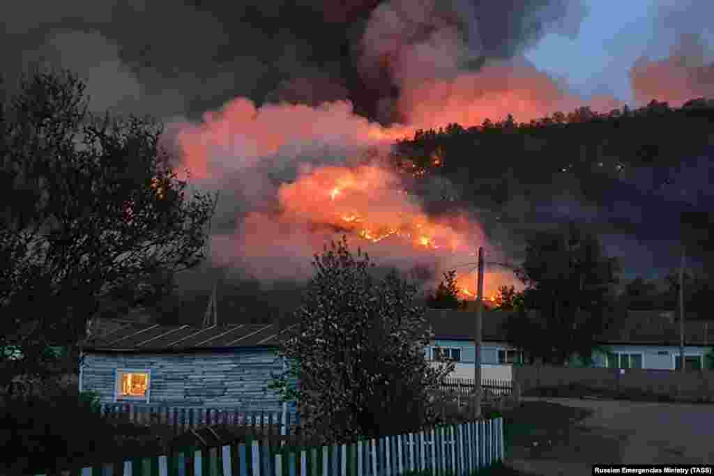 A wildfire in a forest near the village of Anavgai in the Bystrinsky district on Russia's Kamchatka Peninsula. (TASS/Russian Emergencies Ministry)