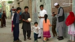 Family Of Afghan Boy With Messi-Signed Soccer Jerseys Flees To Pakistan