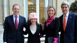 U.S. -- State Dept. Spokesperson Psaki Poses in a New Hat With Russian Counterpart and Their Respective Bosses (from 2014)