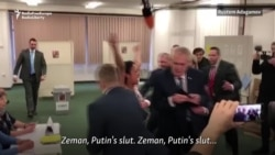 Topless Activist Confronts Czech President In Polling Station