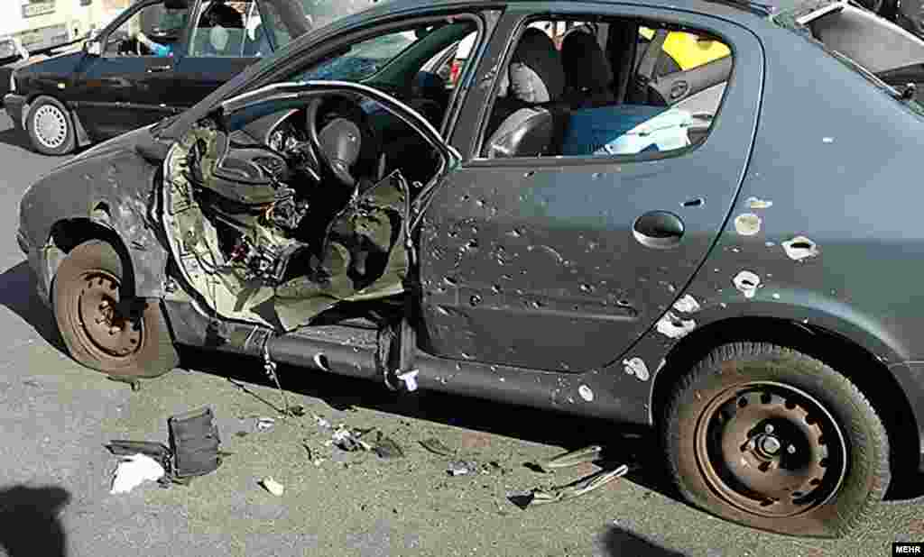 Shahriari's vehicle after he was killed in a blast in Tehran in November 2010. The scientist was also killed by a bomb attached to his door by motorcyclists.