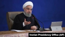 Iranian President Hassan Rohani speaking at a cabinet meeting in Tehran on December 2.