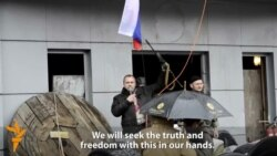 Protest Leader Brandishes AK-47 At Pro-Russian Rally In Luhansk