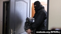 Security forces search the offices of the Association of Belarusian Journalists in Minsk on February 16.