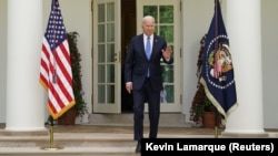 U.S. President Joe Biden salutes as he arrives to speak about the coronavirus disease response and the vaccination program from the Rose Garden of the White House in Washington on May 13.