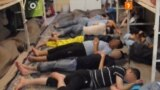 A frame grab from the hacked video shows an overcrowded cell in Evin prison with inmates sleeping on the floor.
