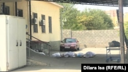 Bodies lie on the ground outside the morgue in the southern Kazakh city of Shymkent on August 13.