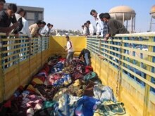 Iraq - Iraqis inspect the bodies of victims who were killed in the Tal Afar attacks conducted by unknown gunmen two days ago in Mosul, 29Mar2007
