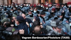 Armenian police officers clash with demonstrators in Yerevan on January 28.