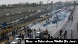 People protest against the government, blocking a highway in Tehran, Iran November 16, 2019.