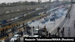 People protesting higher gas prices and government policies on a highway in Tehran, Iran November 16, 2019.