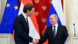 RUSSIA -- Russian President Vladimir Putin, right, and Austrian Chancellor Sebastian Kurz shake hands after a joint news conference following their talks in the Kremlin in Moscow, Russia, Wednesday, Feb. 28, 2018.