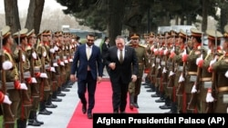 AFGHANISTAN -- U.S. Secretary of State Mike Pompeo, right, and Afghan National Security Adviser Hamdullah Mohib, arrives at the Presidential Palace in Kabul, March 23, 2020