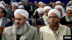 Molavi Abdol Hamid Ismaeelzahi (L), a Sunni theologian and a spiritual leader of the Sunni community in Iran, in a meeting of Sunni clerics with president Rouhani, on Sunday December 11, 2016.