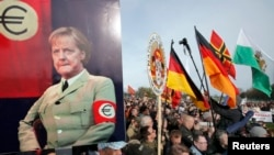 Supporters of Pegida take their anger out on Germany's chancellor, Angela Merkel.