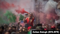 Hungarian fans march toward Puskas Arena before the match in Budapest on June 15.