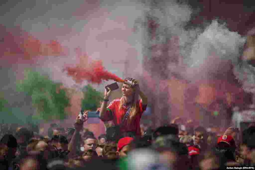 Hungarian soccer fans march toward the Puskas Arena in Budapest ahead of their country's Euro 2020 game with Portugal on June 15.