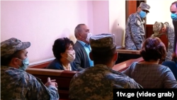 Natalia Ilychova (left) and Iveri Melashvili appear in a Tbilisi court on October 7.