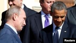 """Президент России Владимир Путин (слева) и президент США Бара Обама (справа) на саммите """"Большой двадцатки"""". Санкт-Петербург, 6 сентября 2013 года."""