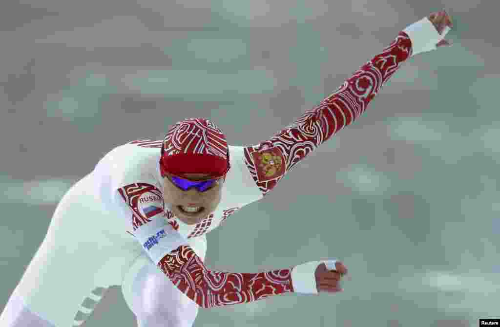 Russia's Olga Fatkulina competes in race two of the women's 500 meters speed skating event. Fatkulina won silver.