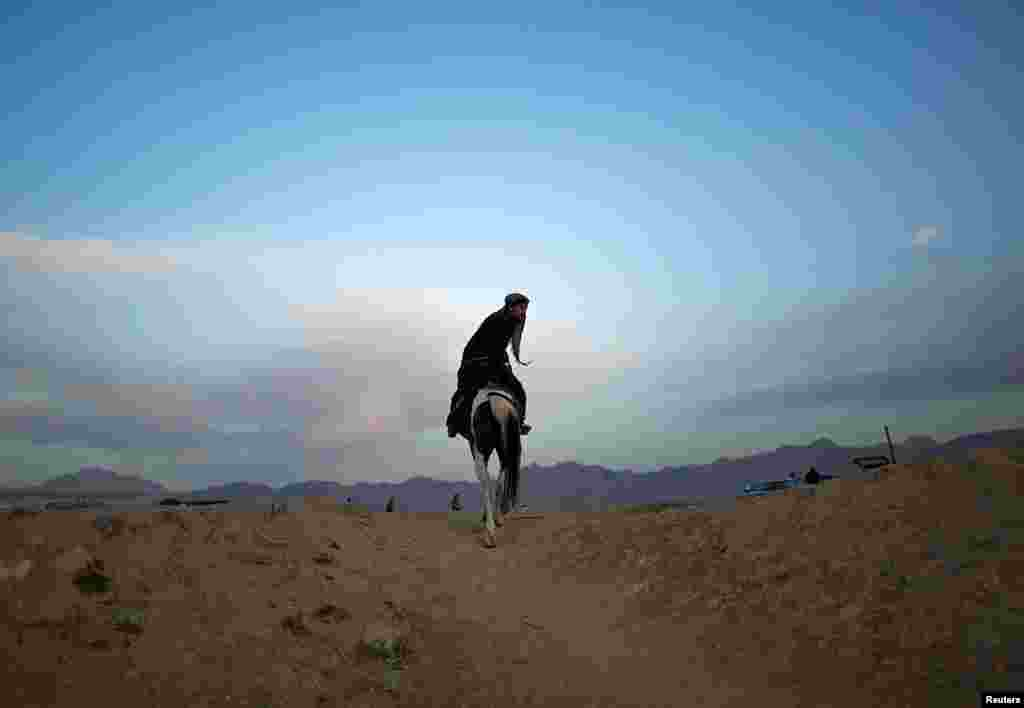 An Afghan man rides a horse as he heads home at the end of a day in Kabul on June 5. (Reuters/Ahmad Masood)
