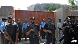 Police commandos guard a UN office in the wake of the suicide blast on October 5.