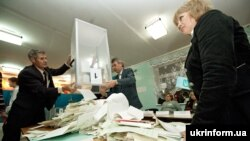 Election officials in Zaporozhye tally votes.