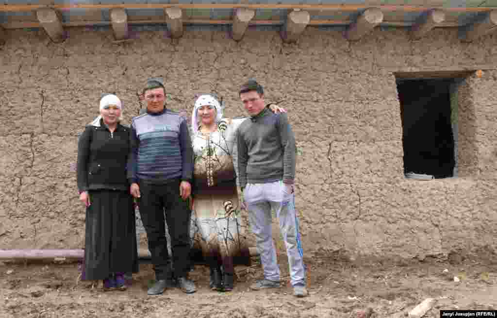 Avaz with his daughter, wife, and youngest son in front of the unfinished house. His oldest son studies English in Kyrgyzstan. The introduction of obligatory paperwork in the Tajik language made Avaz feel alienated as a veterinarian, so he is planning to move to Kyrgyzstan.