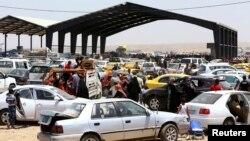 Мосулдан кетіп жатқан тұрғындар. Ирак, 10 маусым 2014 жыл.