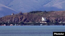 Armenia - A view of Lake Sevan and the medieval Sevanavank monastery, July 24, 2018.