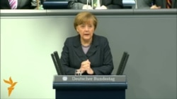 Merkel Warns Russia Of 'Massive' Damage Over Crimea